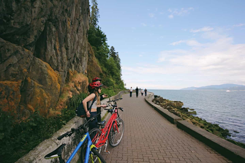 Biking along Stanley Park Seawall in Vancouver, British Columbia