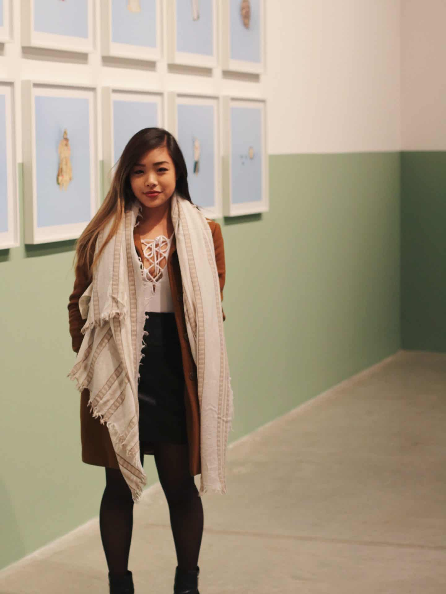 Winter outfit featuring white lace up bodysuit and black leather skirt