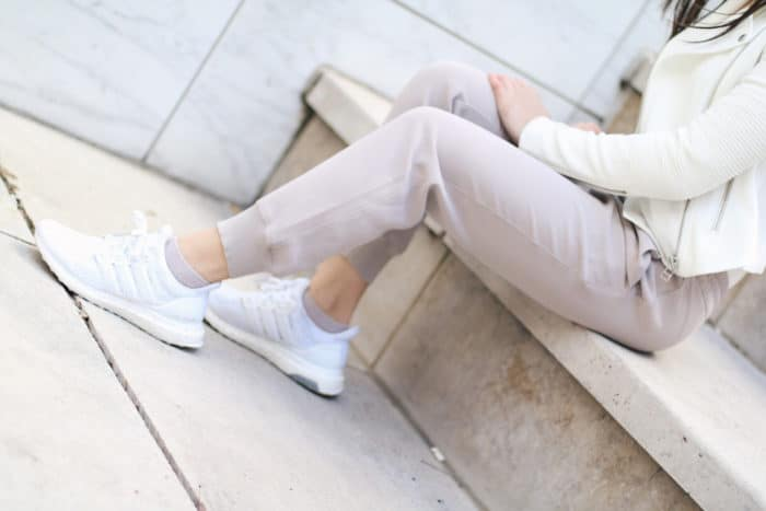 White crossover bodysuit + lilac jogger pants + white adidas sneakers