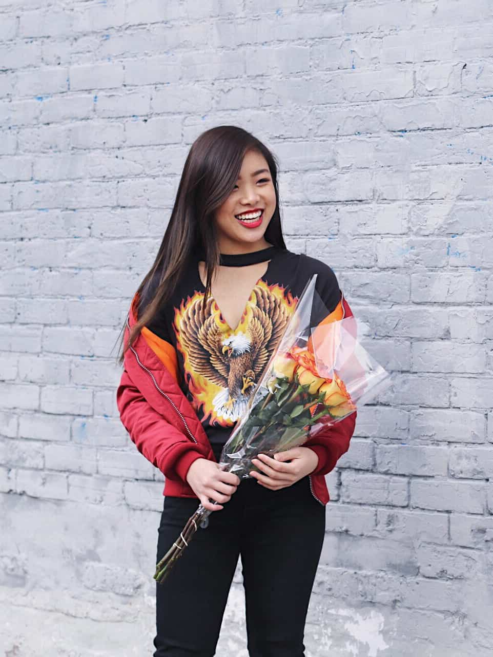 Urban Outfitters choker graphic tee with Alpha Industries red bomber jacket