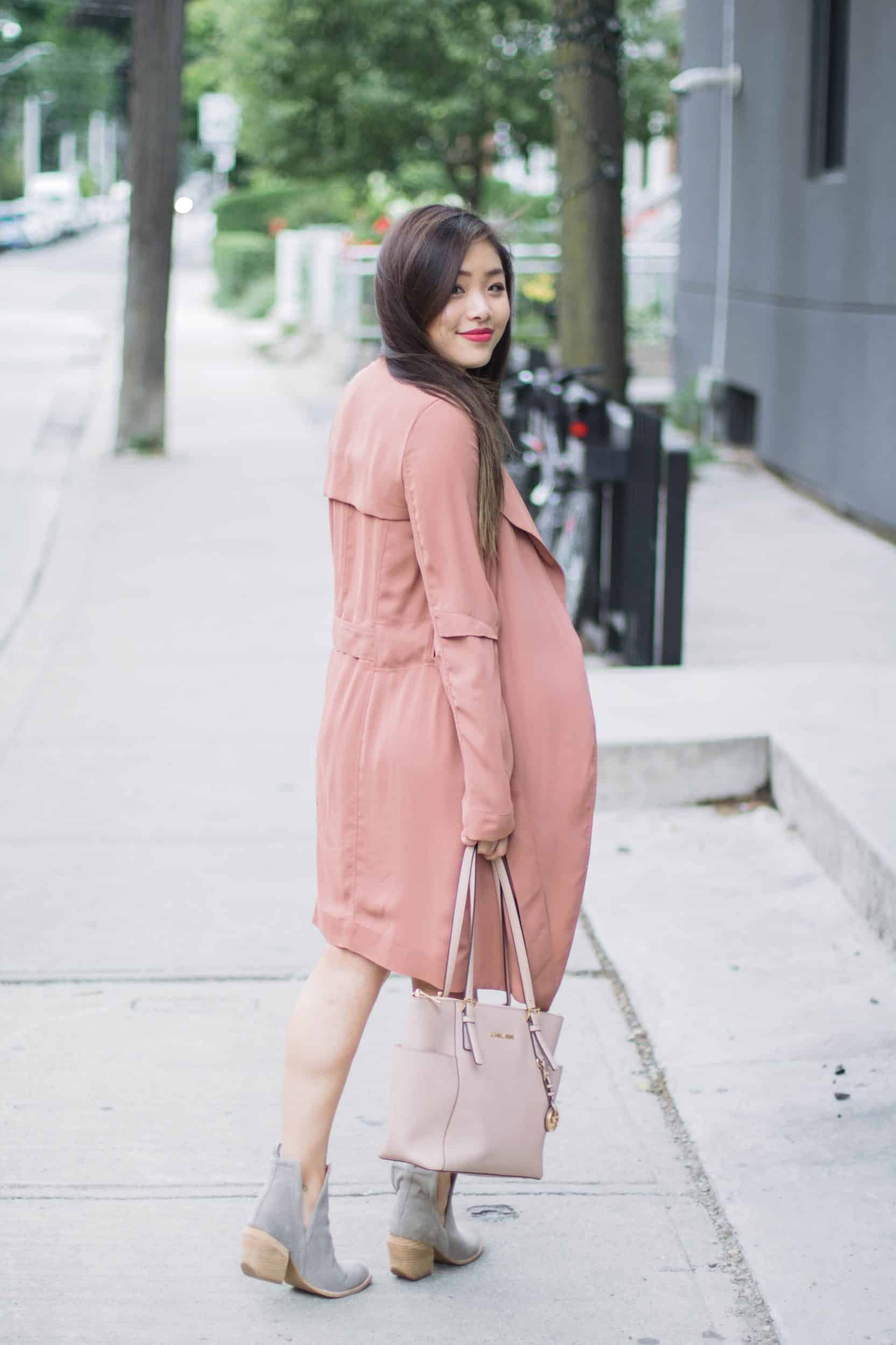 Summer outfit featuring Aritzia pink trench coat, Jeffrey Campbell grey suede booties, and nude Michael Kors bag
