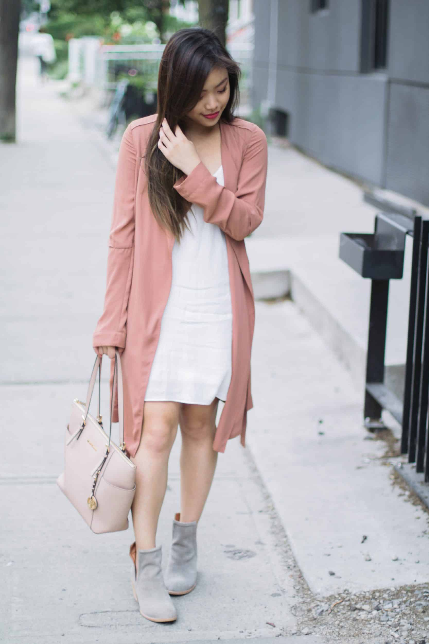 How to style a white slip dress | summer dress with millennial pink duster coat and taupe booties | spring and summer outfit ideas | end of summer outfit inspiration | Diary of a Toronto Girl, a Canadian lifestyle blog