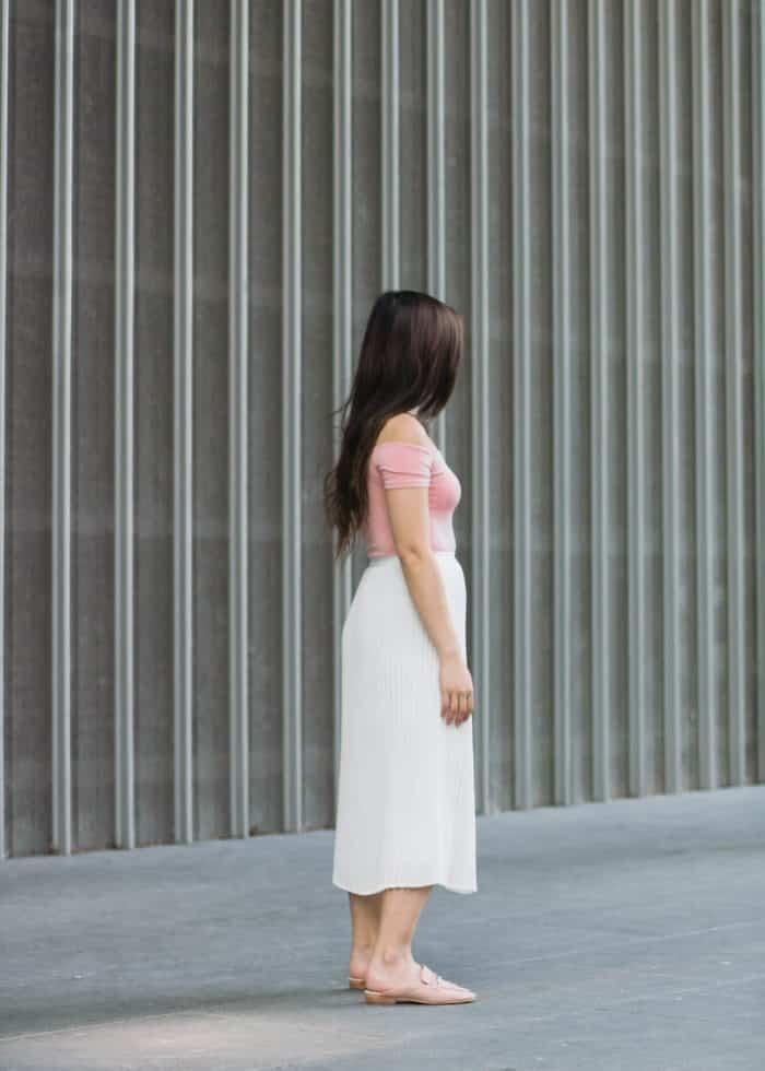 Forever 21 off-the-shoulder bodysuit | Aritzia white pleated midi skirt