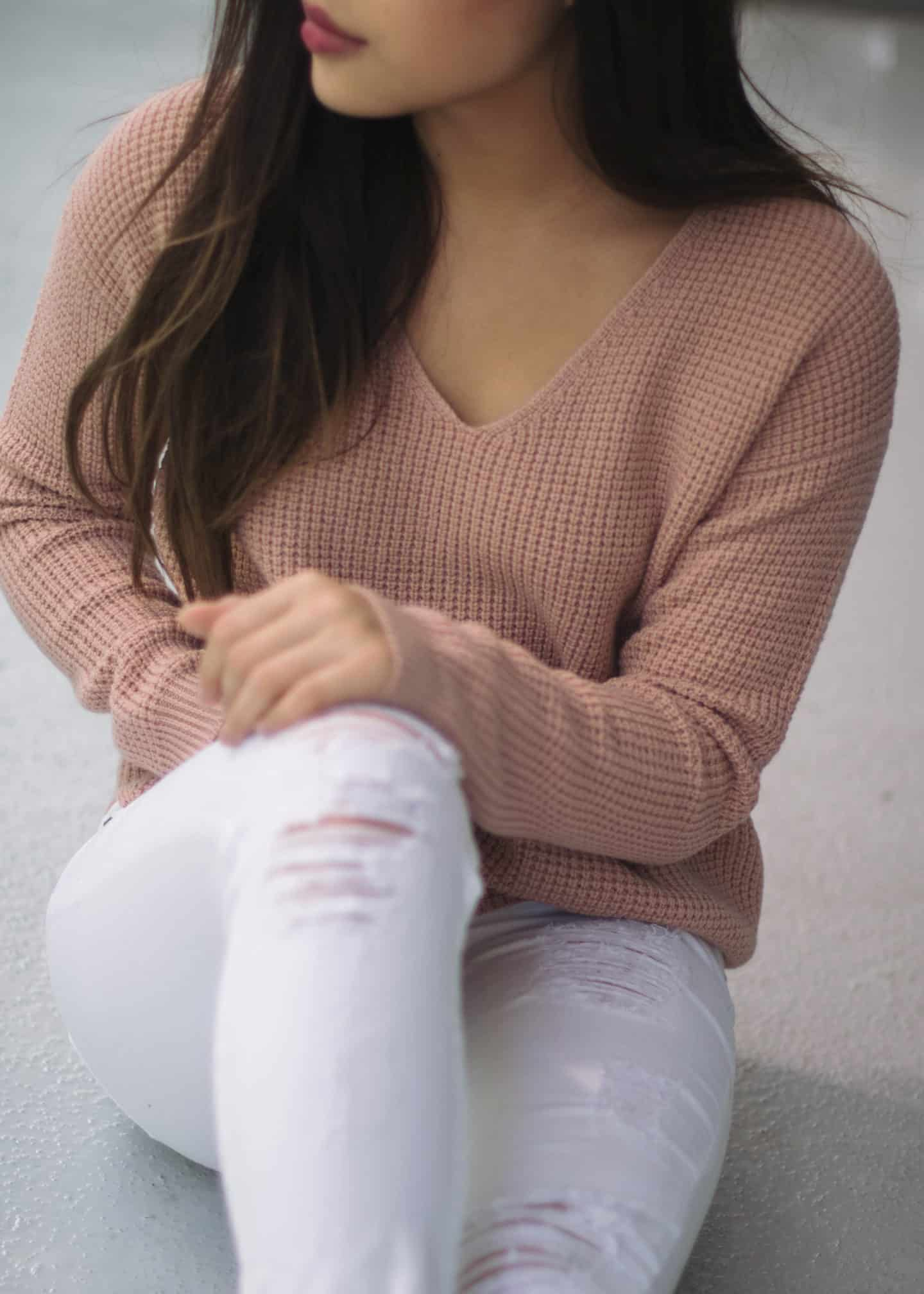 Summer to fall transitional outfit featuring Aritzia pink knit sweater and Guess white distressed jeans