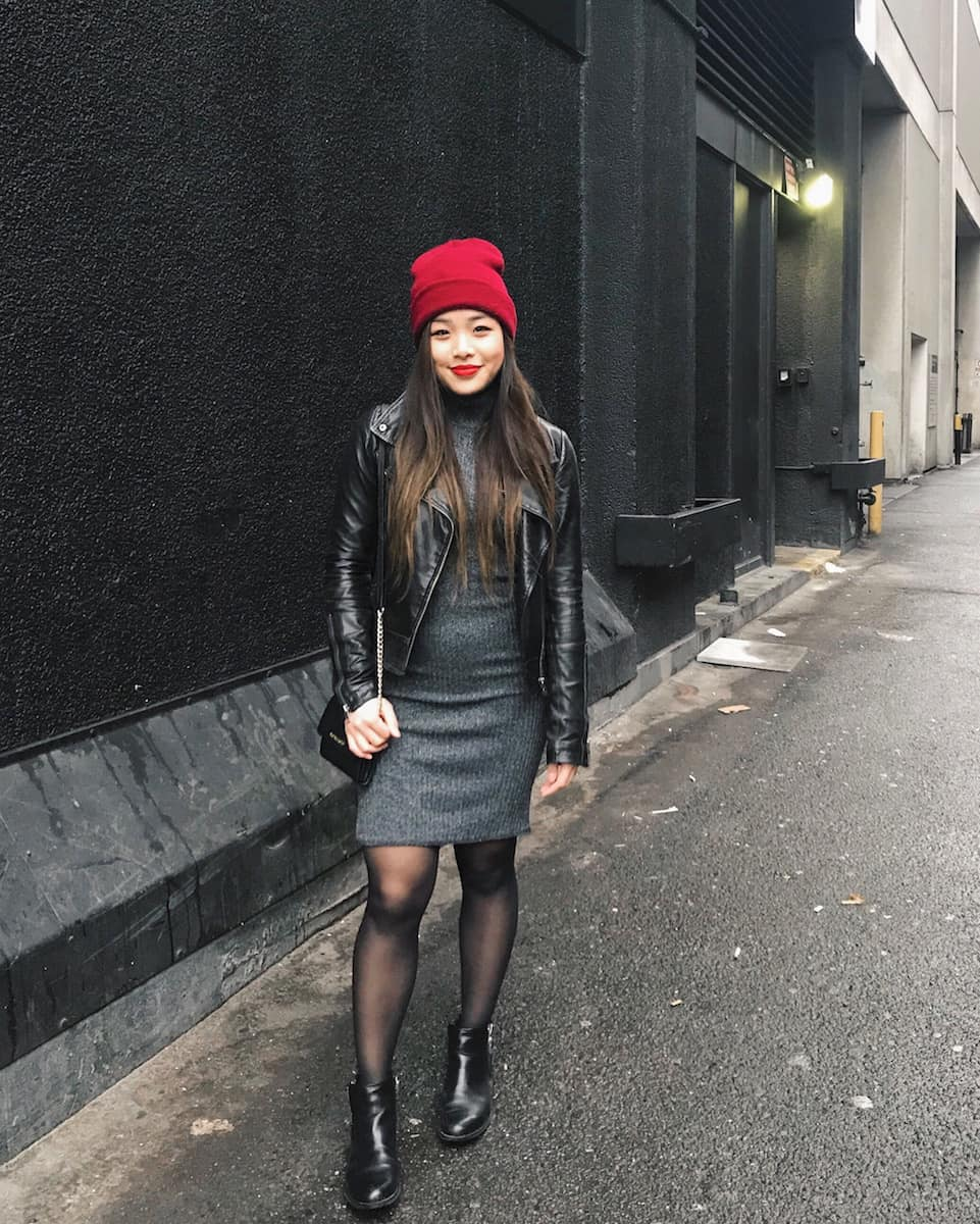 Winter outfit idea featuring American Apparel red beanie, Aritzia turtleneck midi dress, Mackage black leather jacket, and Michael Kors booties