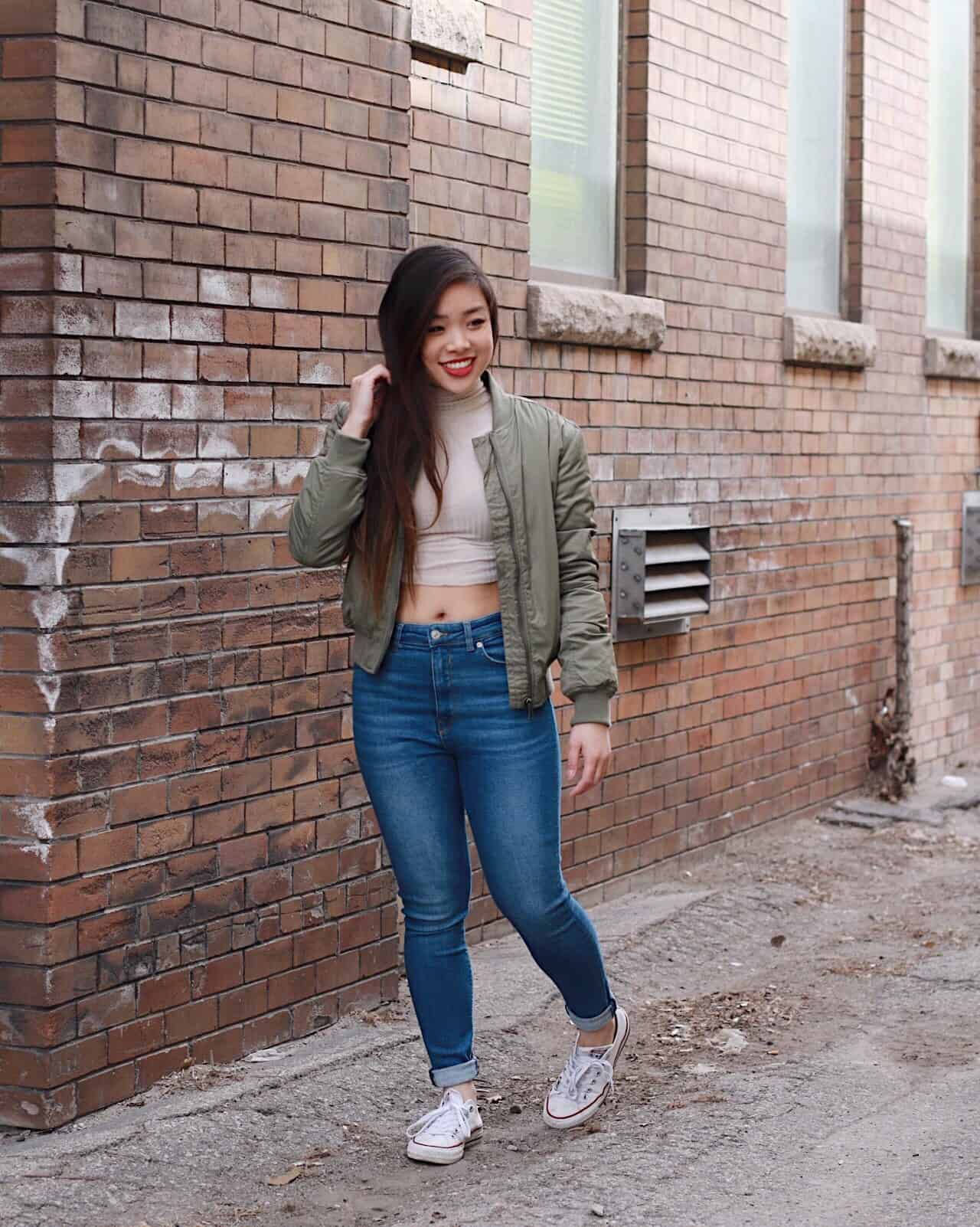 Best jeans for petites   top denim for petite women   how to style high waist jeans for spring   high waisted denim outfit ideas   ivory cropped turtleneck with military green bomber jacket, blue high-waisted denim, and white converse   Diary of a Toronto Girl, a Canadian lifestyle blog