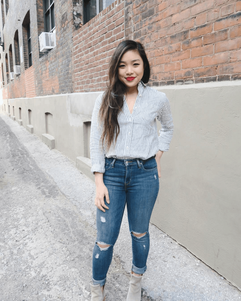 Striped button-up and Levi's ripped blue denim