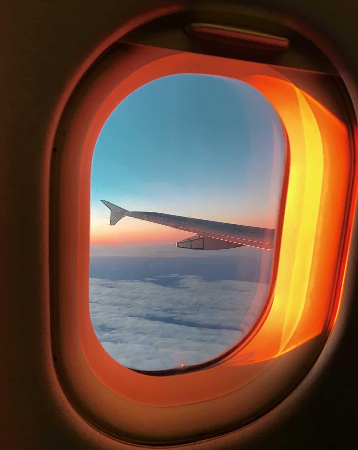 Airplane window during sunrise