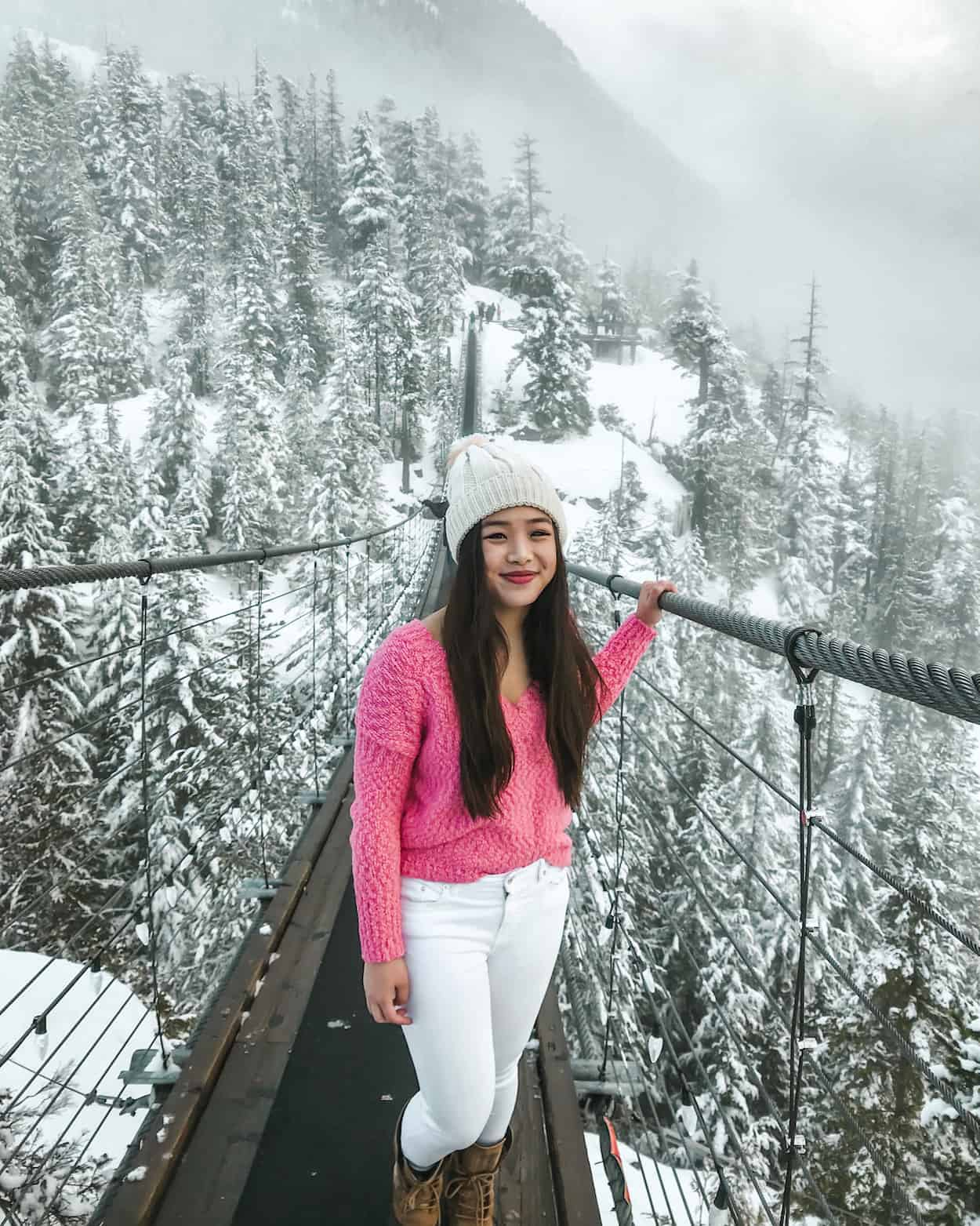A snowy winter view from the top of the Sea to Sky Gondola in Squamish, British Columbia