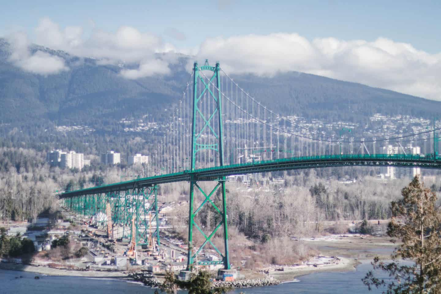 A scenic view of the Lion's Gate Bridge from Stanley Park in Vancouver, British Columbia