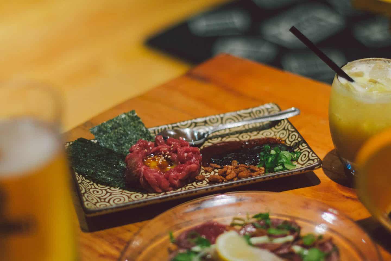 Angus beef yukke dish at Kinka Izakaya in Toronto