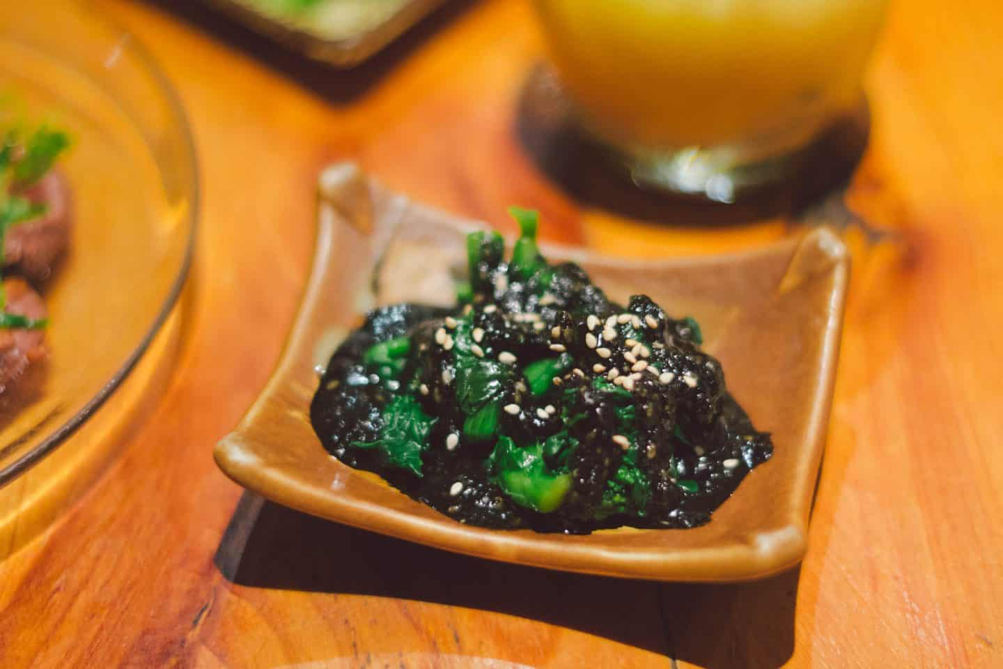 Gomaee is blanched rapini in black sesame sauce.