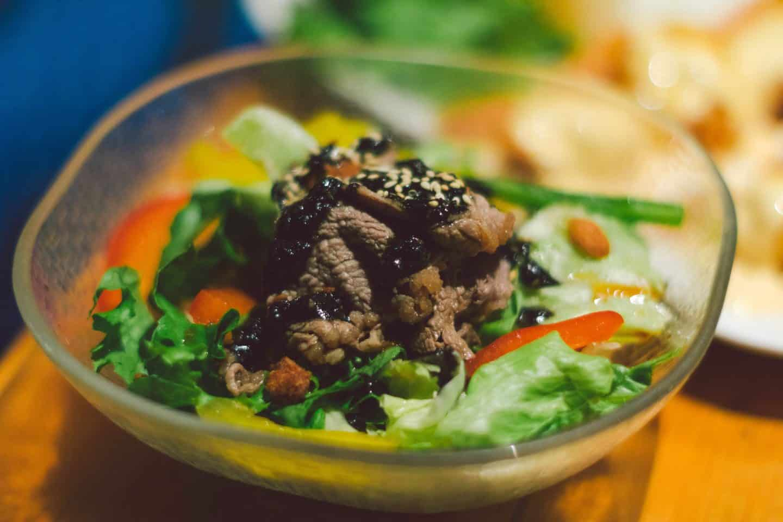 Gyu Shabu Salad with shabu-shabu beef on greens with sesame dressing at Kinka Izakaya