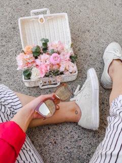 Pretty pink basket of flowers flatlay