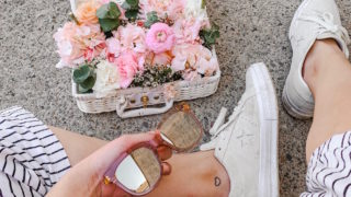 Pretty pink basket of flowers flatlay