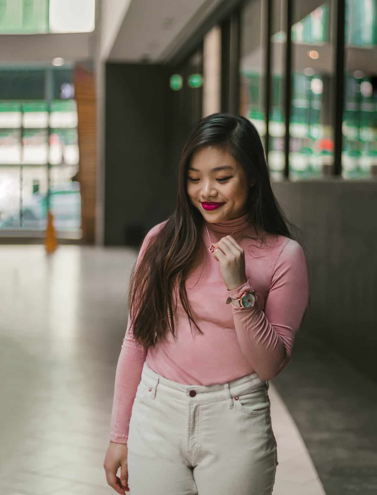 Valentine's Day outfit with a pink turtleneck and ivory corduroy pants