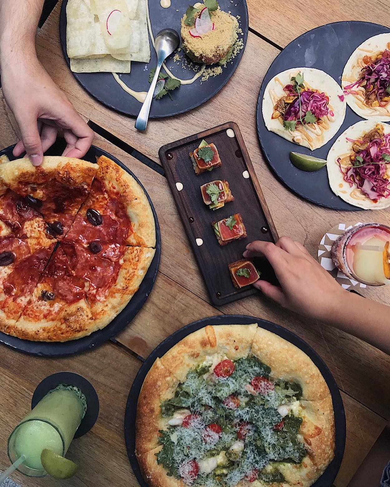 Pizza and appetizers at King Taps Restaurant in Toronto