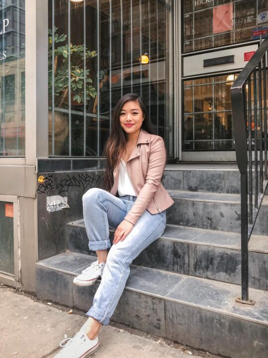 Spring capsule wardrobe outfit - Ever New pink leather moto jacket, Aritzia white camisole, Minkpink blue high waisted jeans, Converse white Chuck Taylor sneakers