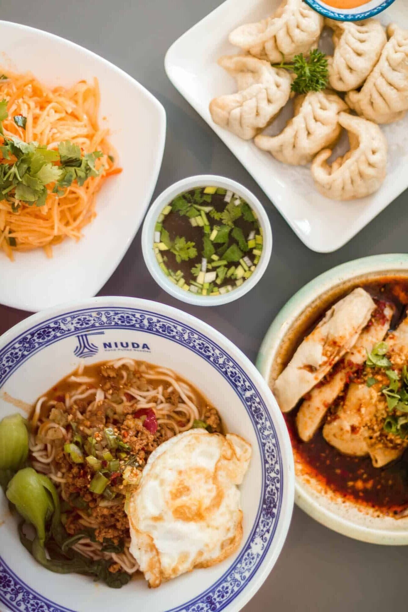 Niuda Hand-Pulled Noodles serves up Chinese noodles in ramen-inspired broth in Toronto