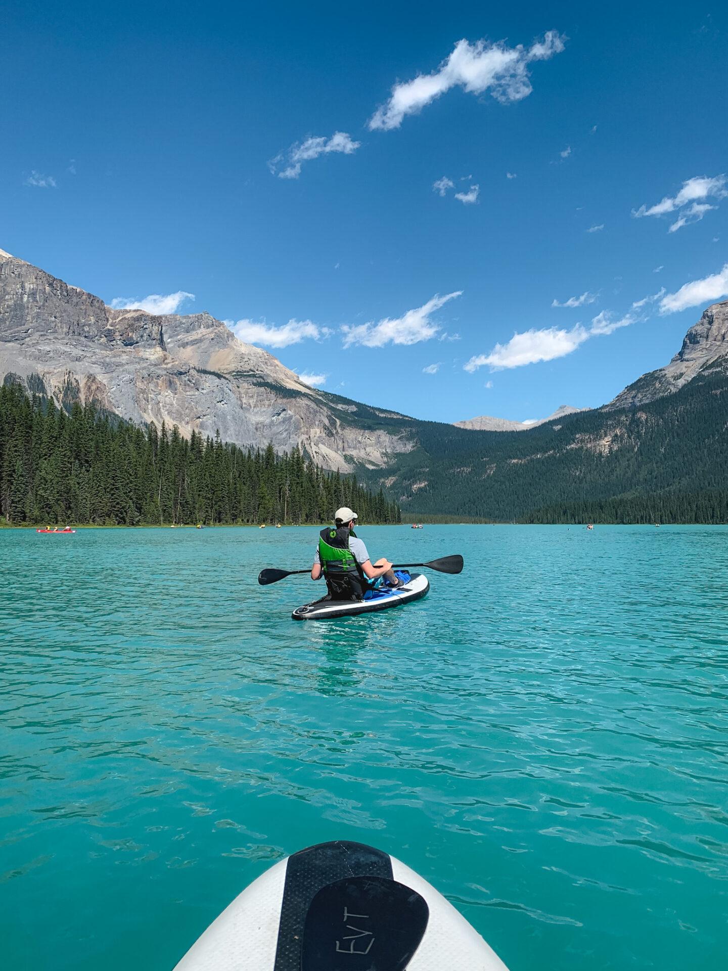 SUP boarding at Emerald Lake in Yoho National Park, British Columbia